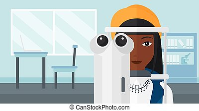 Patient visiting ophthalmologist. - An african-american...