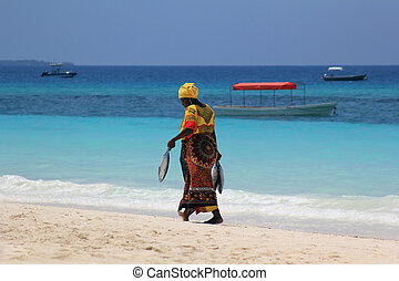 African woman in traditional dress - Zanzibar, Tanzania -...
