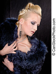 girl in a fur coat on a black background