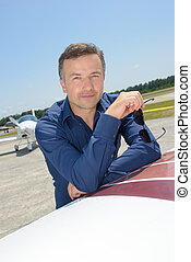 man with airplane in the background