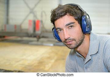 young man with earmuffs