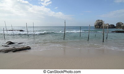 Poles for fishing - Wooden poles for fishing on a beach of...