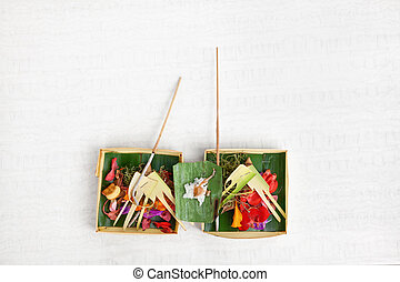 Traditional balinese offering on light background - Canang...