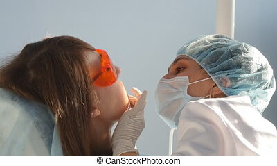 Dentist at work in the office - Young dentist at work in the...