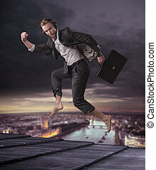 Conceptual picture of a businessman jumping on the top of a...