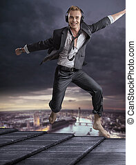 Handsome blond man dancing on the roof