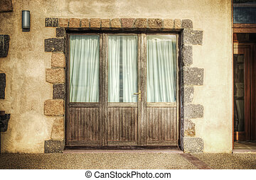 french door in a rustic facade in hdr