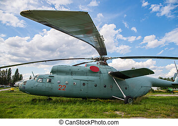 helicopter - military helicopter on a green grass at day