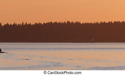 Boat Comes Into View At Sunset - Tug boat sails into view...
