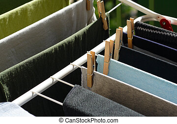 clothes drying, on the dryer with wooden clothes peg