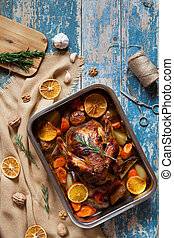 Roasted chicken for christmas with crispy skin in baking...
