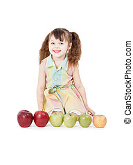 Happy girl playing with apples on white background