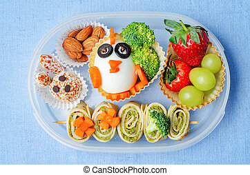 school lunch box for kids with food in the form of funny...