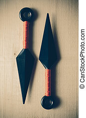 throw ninja weapons with filter effect retro vintage style