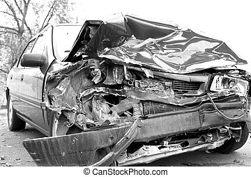 Auto Accidents - A wrecked car lays in wait after a vicious...