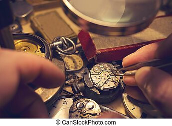 Watchmakers Craftmanship. A watch maker repairing a vintage...