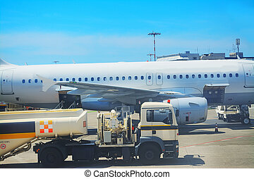 truck by a commercial airplane - fuel truck by a commercial...
