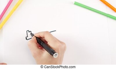 Woman drawing the key using black felt-tip pen on white...