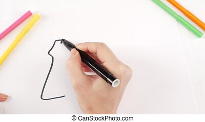 Woman drawing the gun using black felt-tip pen on white...