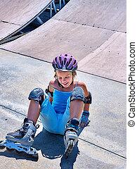 Girl riding on roller skates - Girl in roller skates falling...