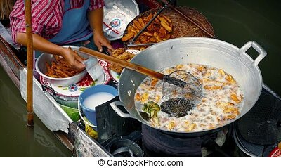 Woman Cooking Bananas River Market - Cooking bananas in oil...