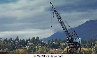 Birds Fly Near Crane Near Mountain - Seagulls flying around...