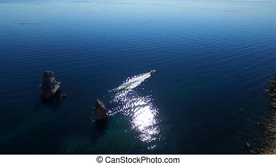 AERIAL VIEW. Small Boat Sailing In Black Sea Waters