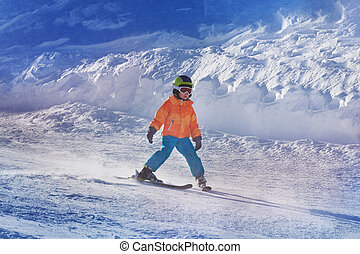 Little boy ski down the mountain by himself - Portrait of a...
