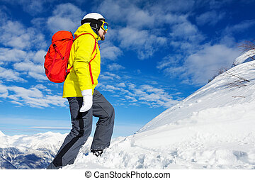 Hiker man on top of the mountain with backpack