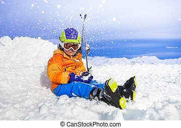 Happy little skier boy throw snow - Little boy with mountain...