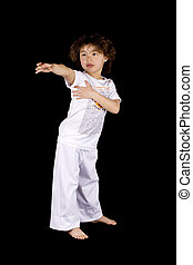 Small girl making karate hit - Cute african american child...
