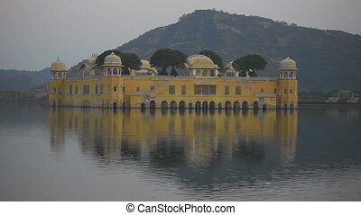 Jal mahal palace on lake at night in Jaipur India -...