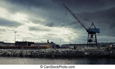 Crane Near Water In Industrial Area - Large old crane in...