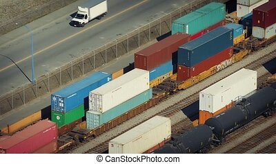 Cars Passing Railway Yard - Vehicles on road next to a yard...
