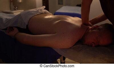 Professional massage male back at beauty spa salon