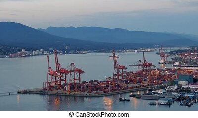 Commercial Shipping Port In Evening - Wide shot of loading...