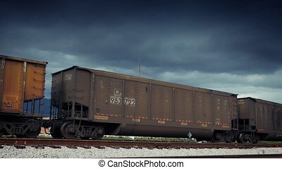 Freight Train Carriages Passing - Large metal boxcars going...