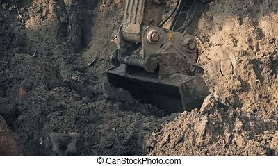 Heavy Digger Shovel Moving Earth - Closeup of large...