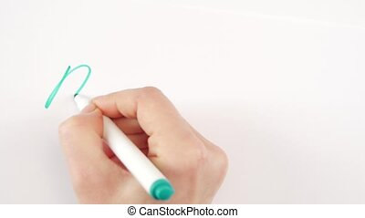 Hand of woman writing goal merry christmas on paper - Hand...
