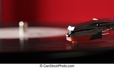 Vintage vinyl record on retro record player turntable -...