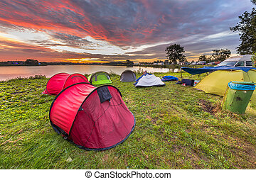 Camping spot with dome tents near lake