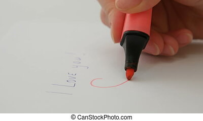 Female hand draws red heart I love you on paper - Female...