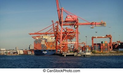 Passing Cranes and Shipyard - Moving passed a commercial...