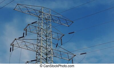 Power Lines With Moving Clouds - Large power lines structure...