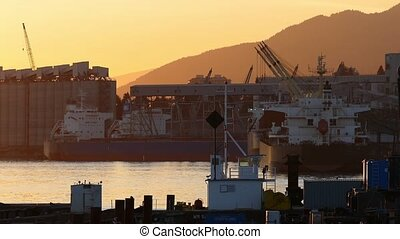Sunset Large Ships In Docking Area - Huge commercial cargo...