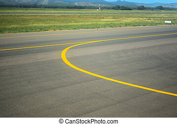 yellow line on an airport taxiway in Italy