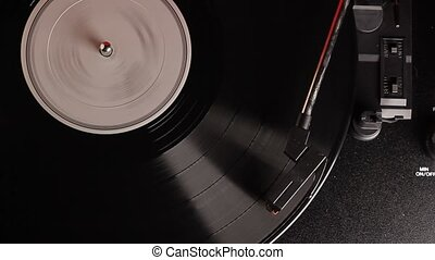 vinyl record played on vintage record turntable player -...