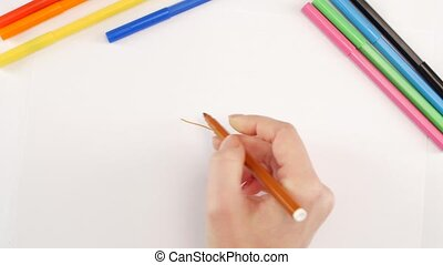 Woman drawing the box using red felt-tip pen on white paper...
