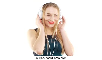 Beautiful girl wearing headphones and dancing - Attractive...