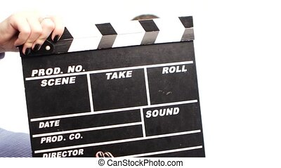 Young woman starts leading news, before it is clapper board...